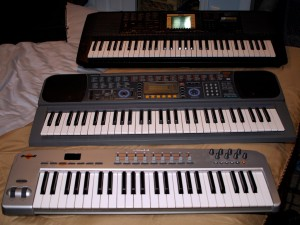 A photo of my three keyboards.  Two are synths, one is just a controller.